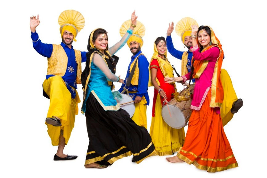 Punjabi couples doing bhangra