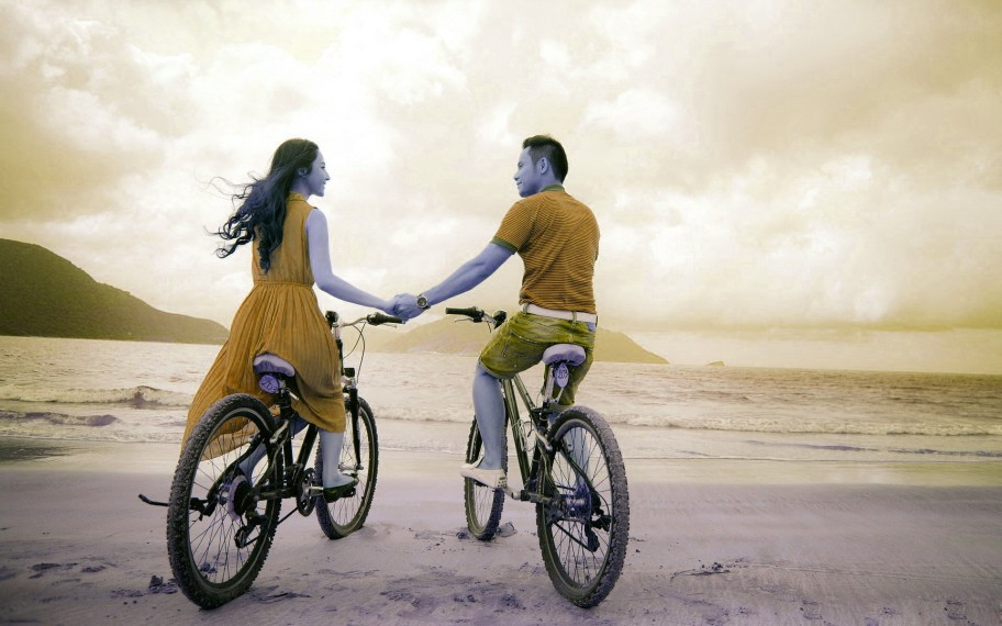 beautiful-girl-and-boy-with-bicycle