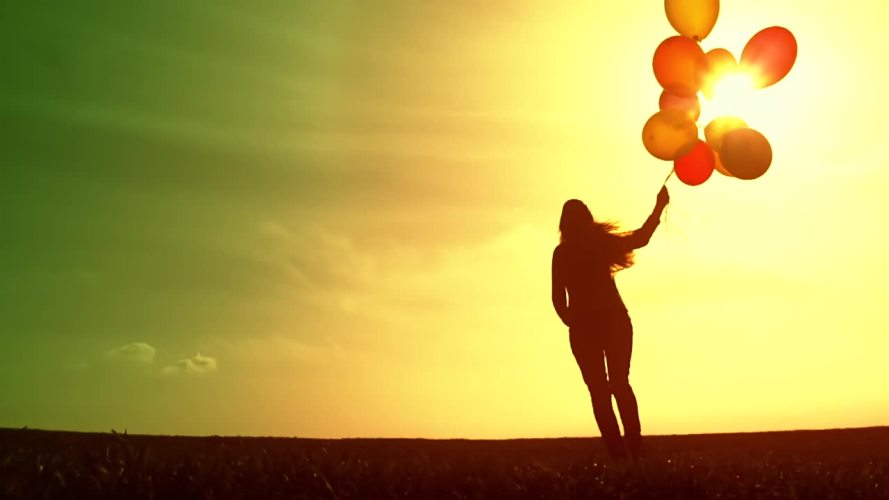 stock-footage-cheerful-happy-woman-enjoying-nature-beautiful-sky-balloons